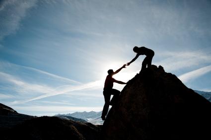 couple-climbing-a-mountain